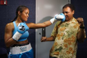 Portrait of Laila Ali sparring with her father, Muhammad Ali, before the IBA/ WBC Super Middleweight Title fight versus Erin Toughill at the MCI Center.  Washington, DC 6/11/2005  (Image # 1227 )