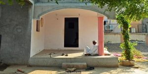 To go with 'India-Religion-Society-Crime' FEATURE by Rachel O'Brien In this photograph taken on November 24, 2014, an Indian resident sits outside the entrance to a home which has no doors, in the village of Shani Shignapur in Ahmednagar District some 200kms east of Mumbai in the western state of Maharashtra. In Shani Shingnapur village in western India, residents see little need for such security, thanks to their belief in special protection from the Hindu deity Shani. AFP PHOTO/ PUNIT PARANJPE (Photo credit should read PUNIT PARANJPE/AFP/Getty Images)