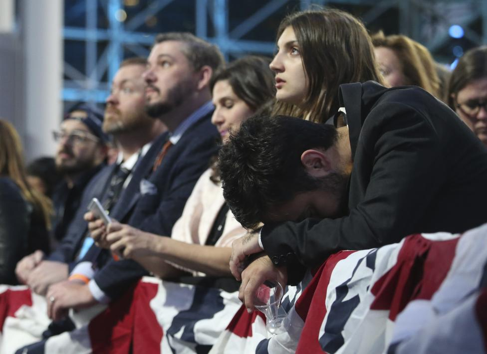 Supporters of Hillary Clinton react as they watch results at the election night rally. REUTERS/Adrees Latif